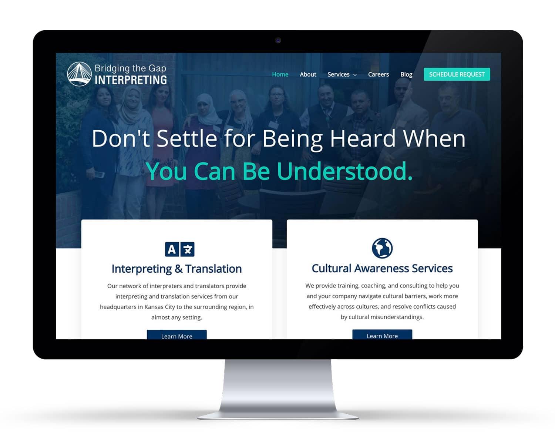 iMac displaying a interpreting translation company website redesign